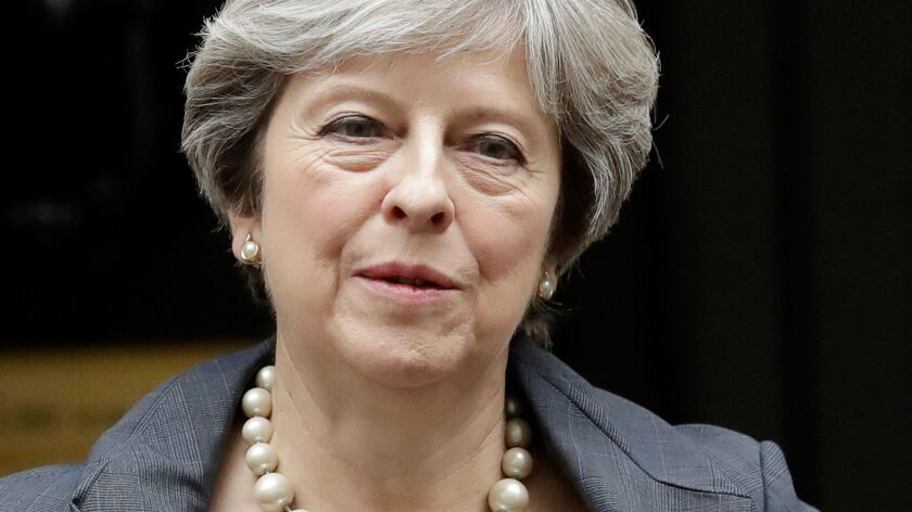 FILE - In this Wednesday, Oct. 11, 2017 file photo, British Prime Minister Theresa May leaves 10 Dow