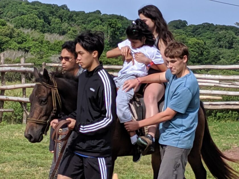 Pacific Ridge students visited the Galapagos Islands to participate in service work, including equine therapy with disabled children.