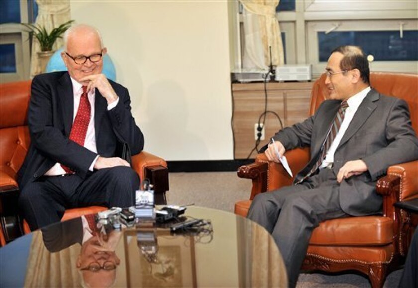 "U.S. President Barack Obama's special envoy on North Korea, Stephen Bosworth, left, talks with South Korea's nuclear envoy Wi Sung-lac during a meeting at the Foreign Ministry in Seoul after returning from North Korea Thursday, Dec. 10, 2009. Bosworth said it remains unclear when the communist regime will return to international disarmament negotiations. However, he said he and his North Korean counterparts reached a ""common understanding"" on the importance of the denuclearization process. (AP Photo/Jung Yeon-je, Pool)"