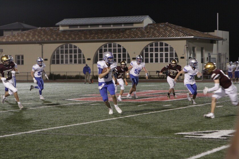 La Jolla Country Day quarterback Bito Bass-Sulpizio gains yardage in a game against La Jolla rival Bishop's in March.