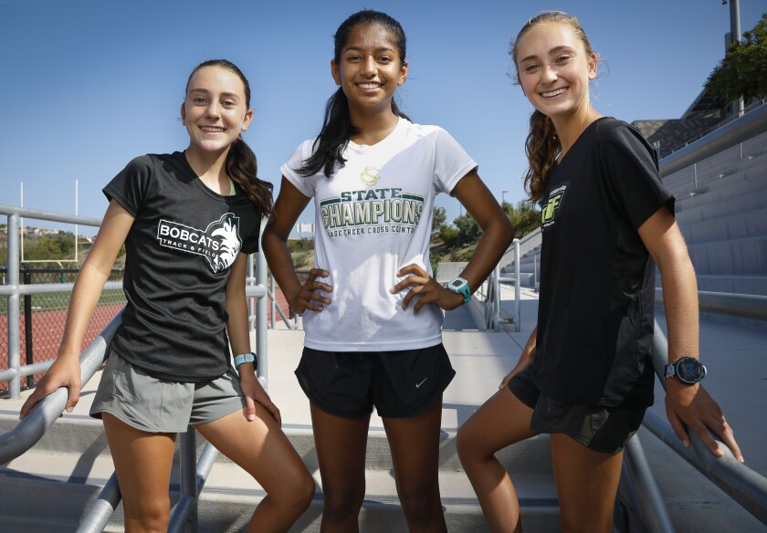 Stormy Wallace, left, Lavanya Pandey, center, and Skyler Wallace, right, are key members of the Sage Creek girls cross country team.