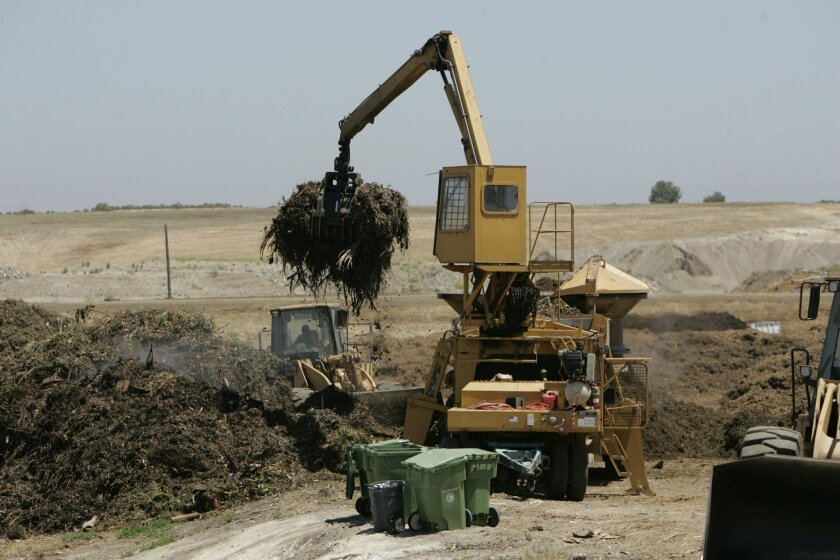 Organic materials are left in piles in the composting process at the El Corazon Green Waste Composting Facility.