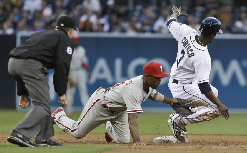 Pedro Ciriaco steals second base ahead of the tag of Philadelphia's Jimmy Rollins in the second inning.