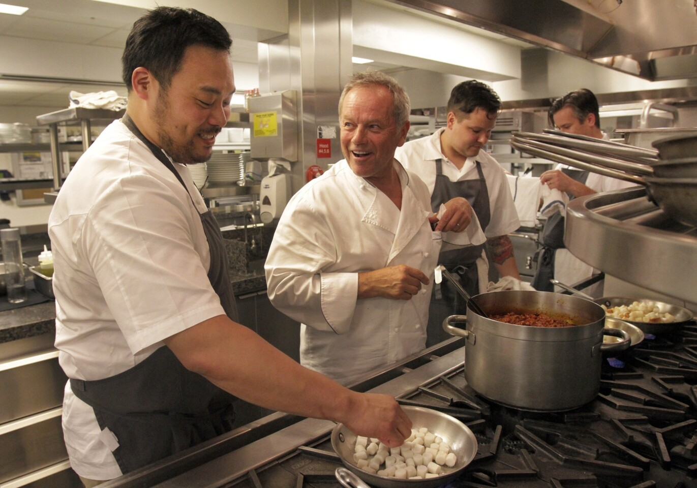 Chefs David Chang, left, and Wolfgang Puck in the kitchen at the Hotel Bel-Air in Beverly Hills.