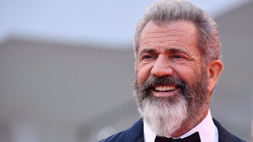 "Mel Gibson spent almost two decades developing ""The Professor and the Madman."" He is shown on the red carpet for ""Hacksaw Ridge"" at the Venice International Film Festival last year."