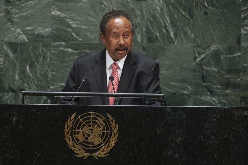 FILE - In this Sept. 27, 2019 file photo, Sudan's Prime Minister Abdalla Hamdok addresses the 74th session of the United Nations General Assembly at the U.N. headquarters. Hamdok has repeatedly urged the West to end his country's international pariah status, arguing it's the only way to save the nation's three-month-old democratic transition from a plunging economy. Hamdok is now turning to two wealthy Gulf Arab monarchies, Saudi Arabia and the United Arab Emirates, to secure funds to keep his government afloat. (AP Photo/Kevin Hagen, File)