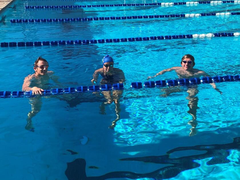 Logan Barrows, Isabella Buonaugurio and Jordan Isham from the Ramona Swim Team at the Ramona High School swimming pool.