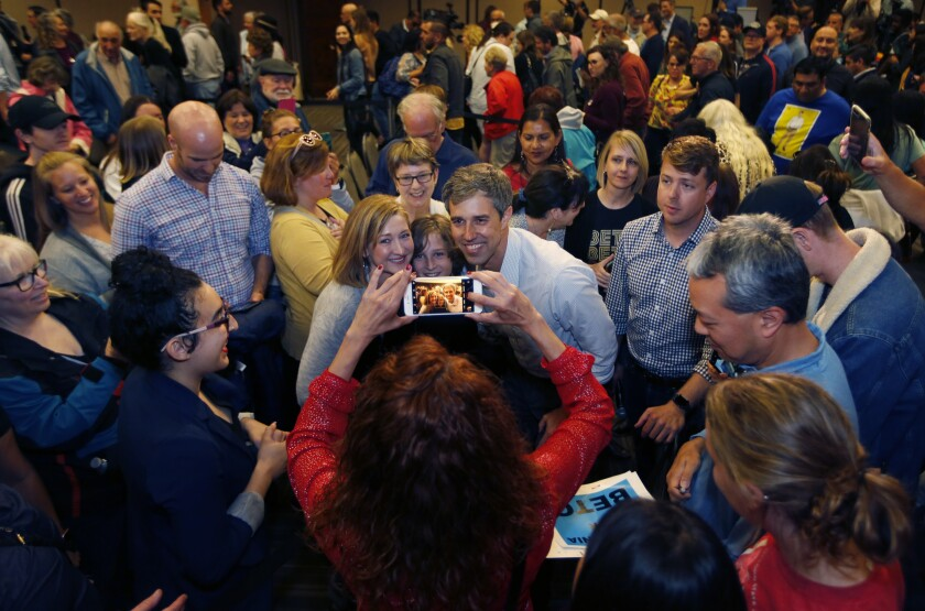 United States presidential candidate Beto O'Rourke takes photos with supporters during a town hall-style rally at the Jacobs Center for Neighborhood Innovation in San Diego on April 30, 2019.