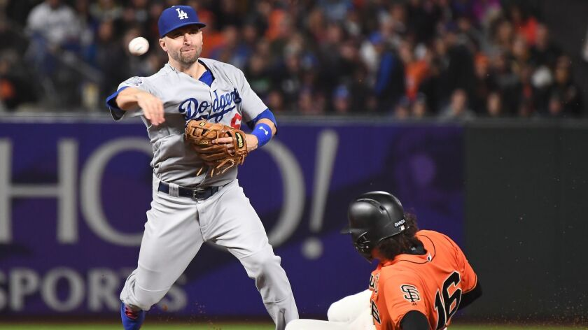 SAN FRANCISCO, SEPTEMBER 28, 2018-Dodgers 2nd baseman Brian Dozier forces out Giants base runner Ara