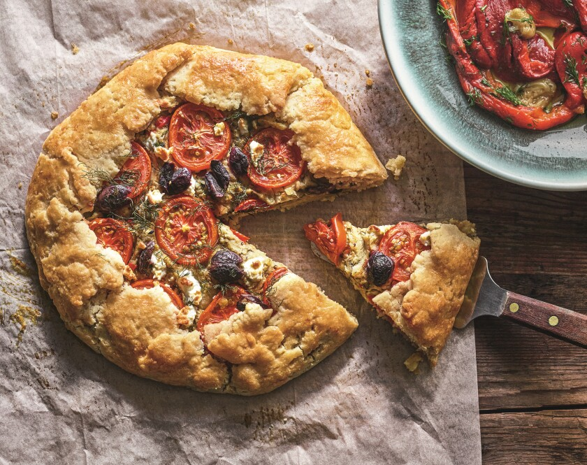 Eggplant Feta Galette topped with tomatoes and Kalamata olives.