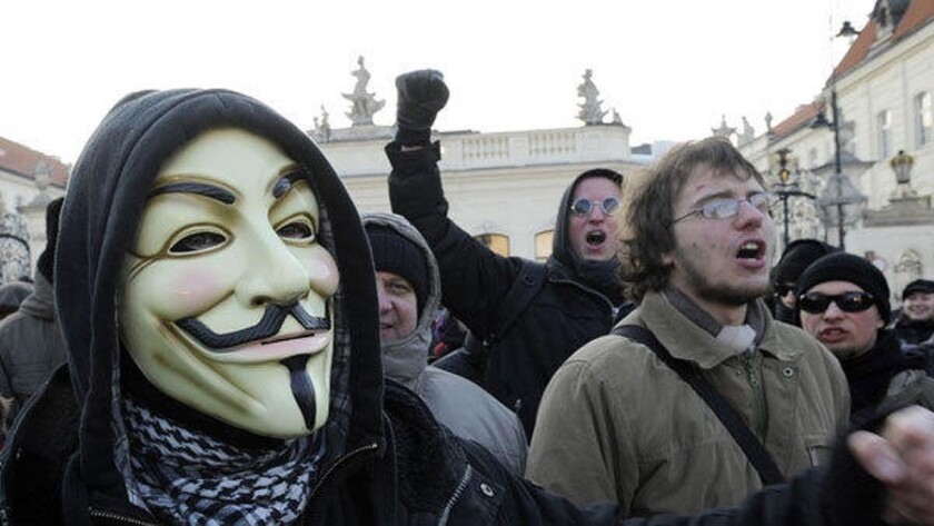 A protester wearing a Guy Fawkes mask, a symbol adopted by the hacker group Anonymous, takes part in a demonstration against the controversial Anti-Counterfeiting Trade Agreement (ACTA) in front of the Presidential Palace in Warsaw.