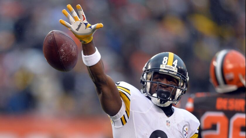 FILE- In this Jan. 3, 2016, file photo, Pittsburgh Steelers wide receiver Antonio Brown (84) reacts