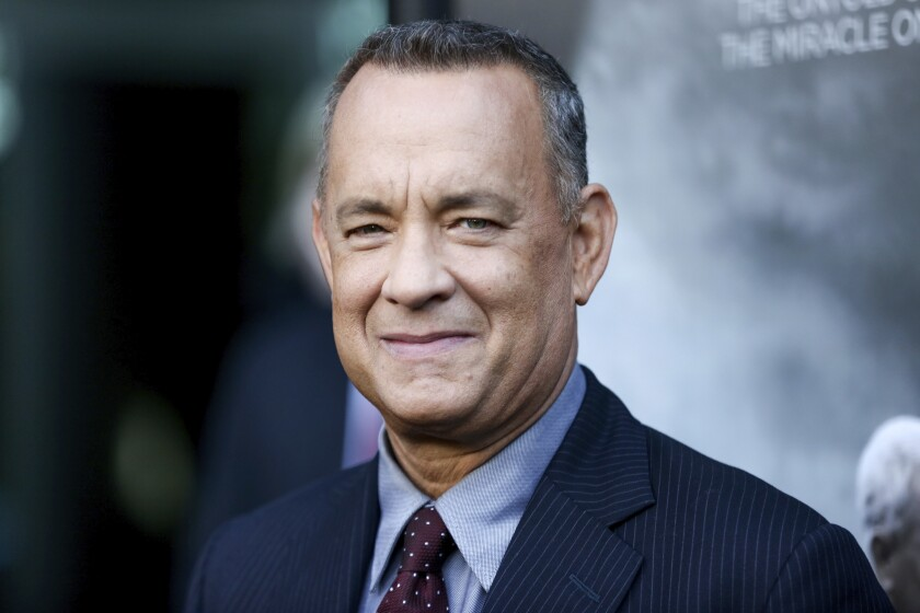 """FILE - In this Sept. 8, 2016 file photo, Tom Hanks arrives at the premiere of """"Sully"""" in Los Angeles. Hanks will be the recipient of the Cecil B. DeMille Award at January's Golden Globes Awards. (Photo by Rich Fury/Invision/AP, File)"""