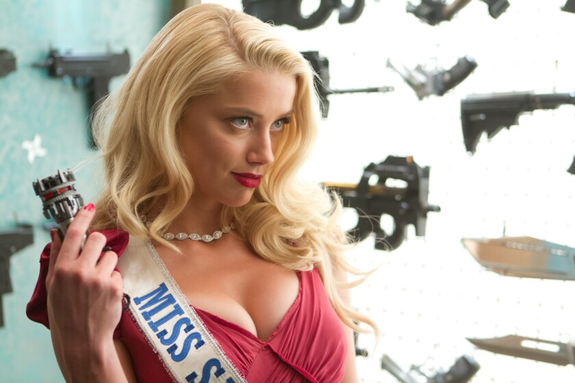 "Amber Heard as Miss San Antonio in ""Machete Kills."""