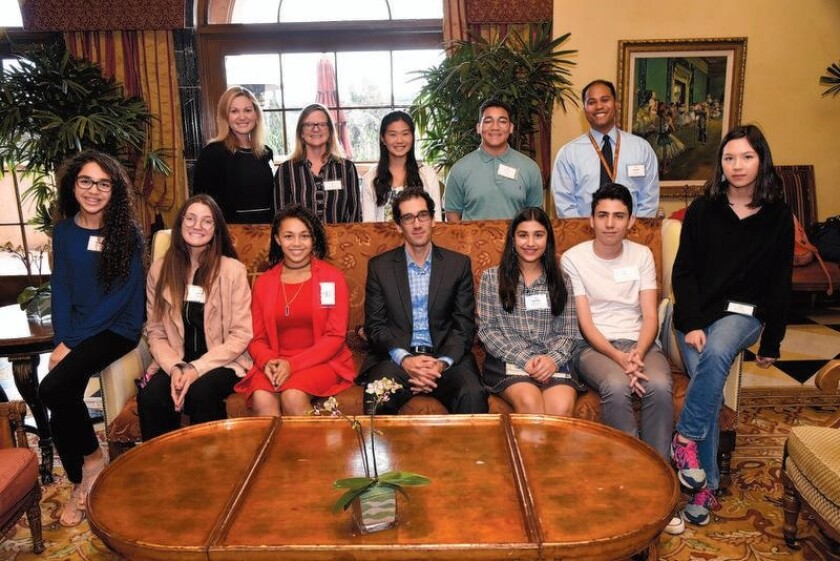 Standing: Torrey Pines High School teacher Heather Lopez, Department Chair Lisa Callender, students Christine Tsu, Shonne Davis, Assistant Principal Michael Santos, Seated: Students Mariam Kharraz, Alyssa Baker, Maya White, author Daniel Mason, students Melody Abouzari, Emre Gumus, Lana Messenger