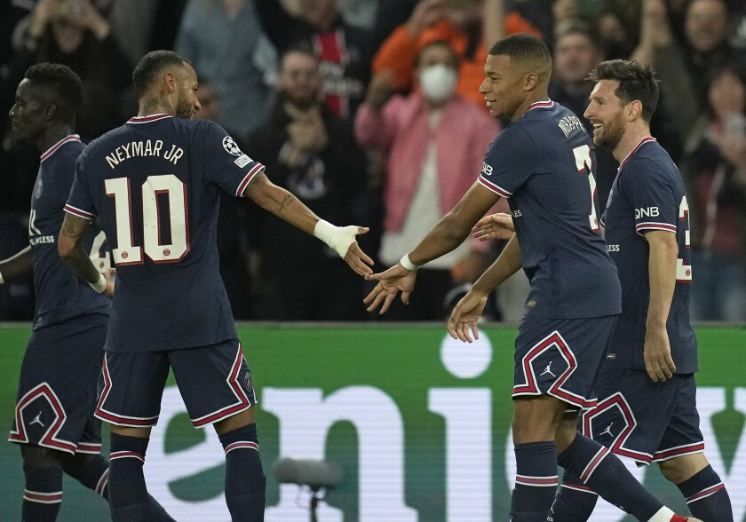 PSG's Lionel Messi, right, celebrates with Neymar and Kylian Mbappe after scoring his side's second goal during the Champions League Group A soccer match between Paris Saint-Germain and Manchester City at the Parc des Princes in Paris, Tuesday, Sept. 28, 2021. (AP Photo/Christophe Ena)