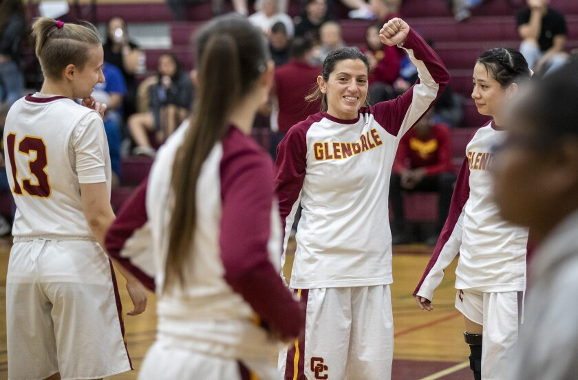 Glendale Community College guard Vicky Oganyan raises a fist during halftime of a game against College of the Canyons on Feb. 12.
