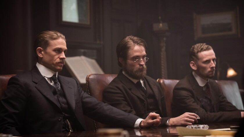 """Charlie Hunnam, left, Robert Pattinson and Edward Ashley in the film """"Lost City of Z."""""""