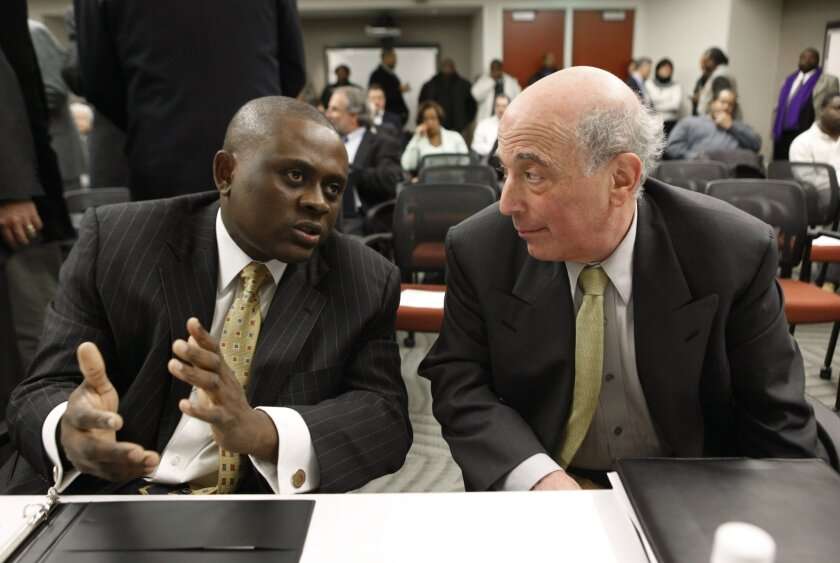 FILE - In this Jan. 4, 2010, file photo, Dr. Bennet Omalu, left, Co-Director, Brain Injury Research Institute, West Virginia University,  talks with Dr. Ira R. Casson, Neurologist and former co-chairman, NFL Mild Traumatic Brain Injury Committee, before a House Judiciary Committee hearing entitled