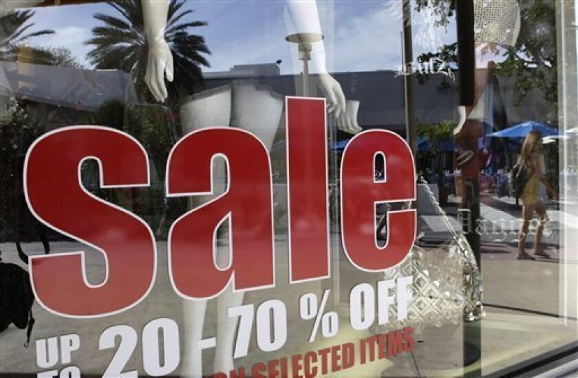 In this March 1, 2010 photo, Envy Collection advertises clothing on sale at the Lincoln Road pedestrian mall in Miami Beach, Fla. A private trade group says growth in the U.S. service sector accelerated in February to its fastest rate in more than two years.(AP Photo/Lynne Sladky)