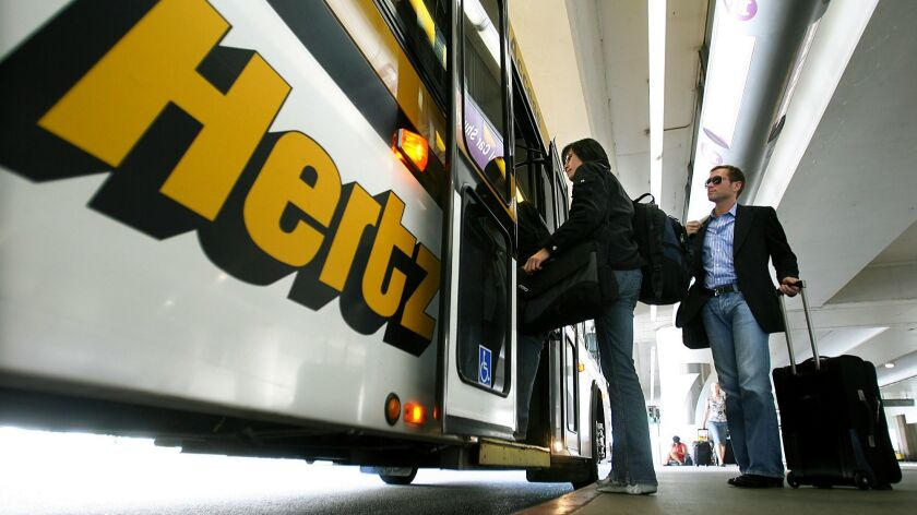 A satisfaction study by J.D. Power found that renting cars got the highest satisfaction ratings among all elements of travel. Above, customers board a Hertz rental bus at Los Angeles International Airport.
