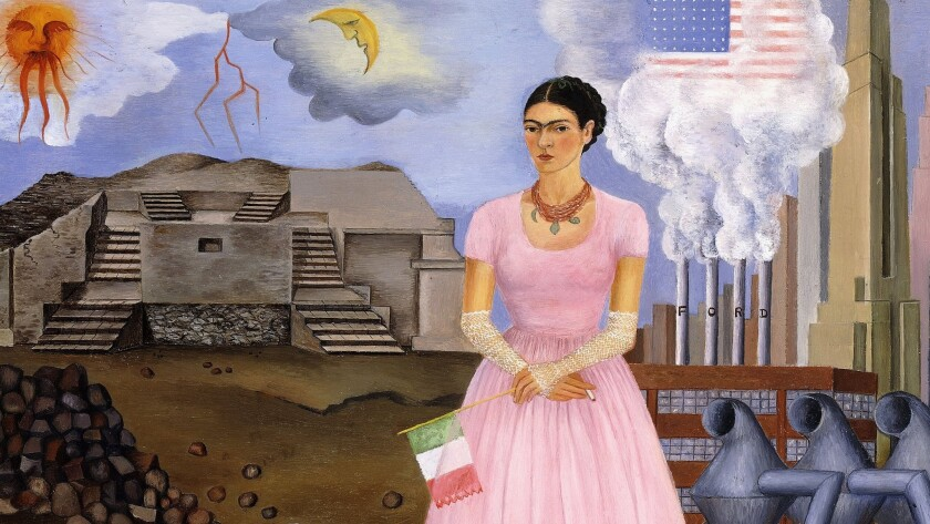 "Frida Kahlo, dressed in pink and lace and audaciously smoking in front of a smoke-belching Ford factory, in ""Self-Portrait on the Border between Mexico and the United States (detail),"" 1932"