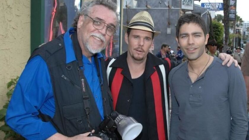 "E.L. Woody, left, on the set of ""Entourage"" with Kevin Dillon, center, and Adrian Grenier."