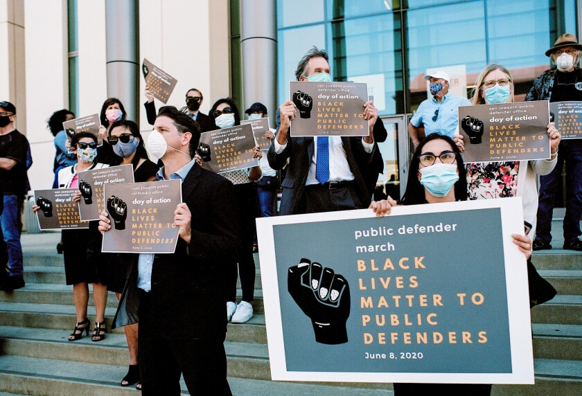 San Joaquin County public defenders protest outside the county courthouse last month in Stockton, Calif.