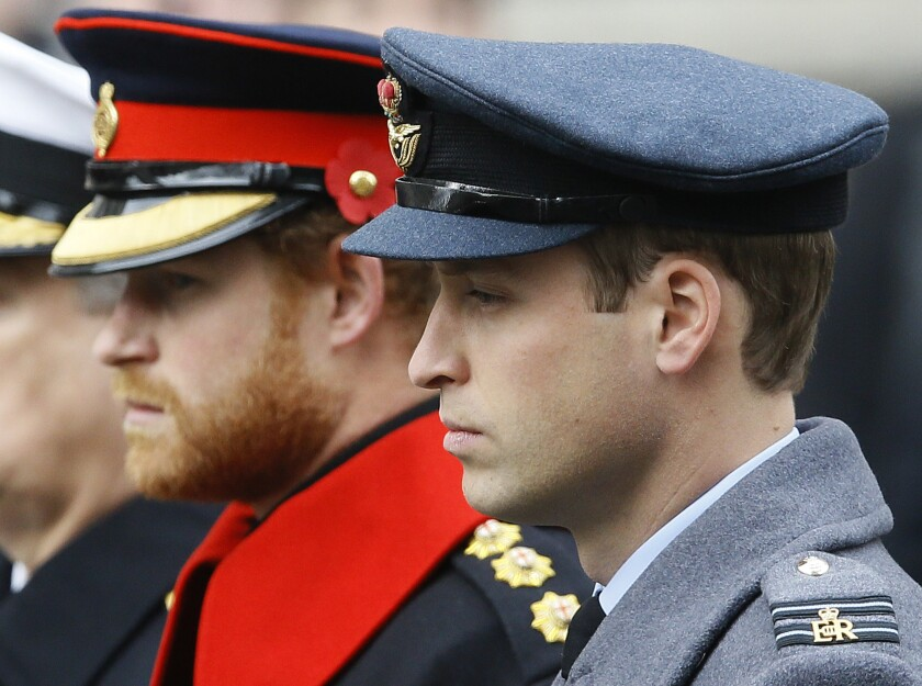 FILE - In this Sunday Nov. 8, 2015 file photo, Britain's Prince William, right, and Prince Harry attend the Remembrance Sunday ceremony at the Cenotaph in London. Senior royals must wear civilian clothes to Prince Philip's funeral, defusing potential tensions over who would be allowed to don military uniforms. Queen Elizabeth II's decision means Prince Harry won't risk being the only member of the royal family not in uniform during the funeral on Saturday April 17, 2021 for his grandfather, who died last week at the age of 99. (AP Photo/Kirsty Wigglesworth, File)