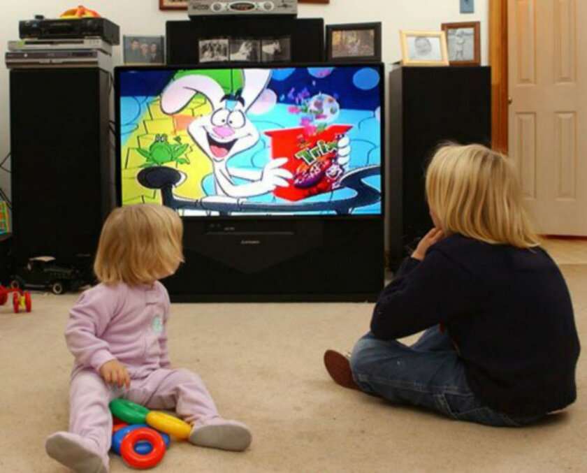Dr. Mark DeBoer from the University of Virginia, author of a new study on TV viewing and weight gain, said he hopes the findings from his research will prompt policy makers to shift more resources to programs and services that help children become more active. / AP file photo
