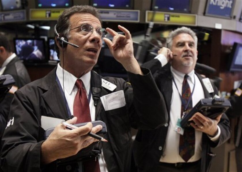 Traders Sal Suarino, left, and Robert Degaetano work on the floor of the New York Stock Exchange Tuesday, May 31, 2011. (AP Photo/Richard Drew)
