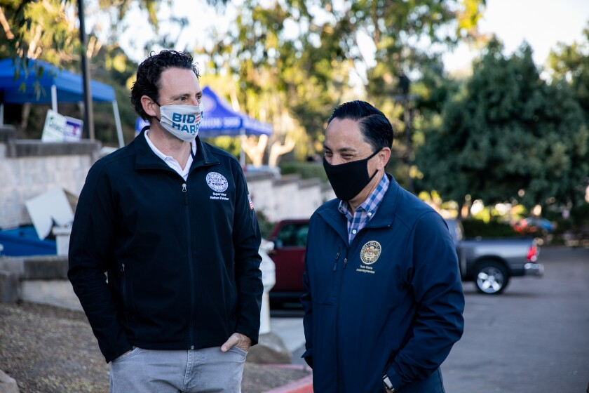 San Diego County Supervisor Nathan Fletcher, left, talks with state Assemblyman Todd Gloria.