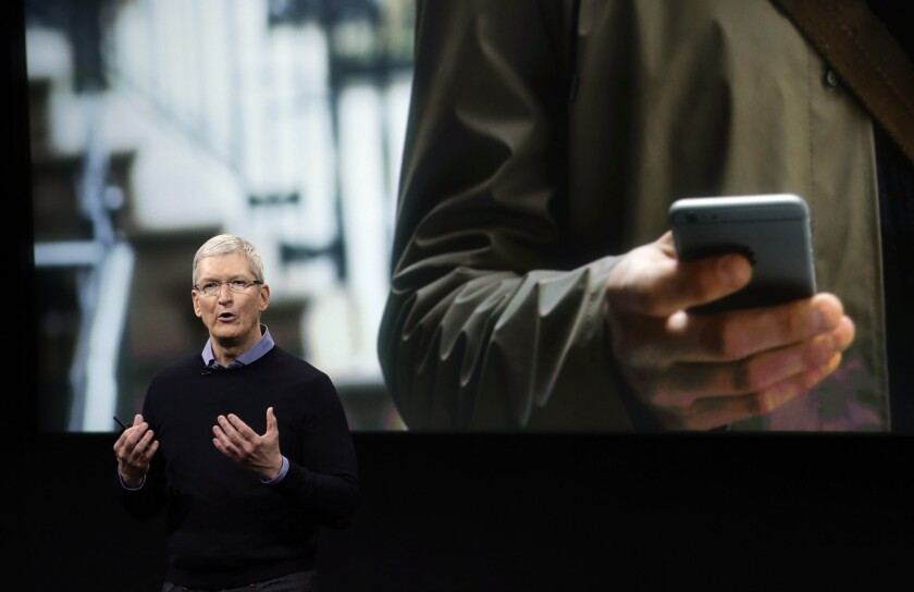 Apple CEO Tim Cook speaks at an event to announce new products at Apple's headquarters in March 2016.