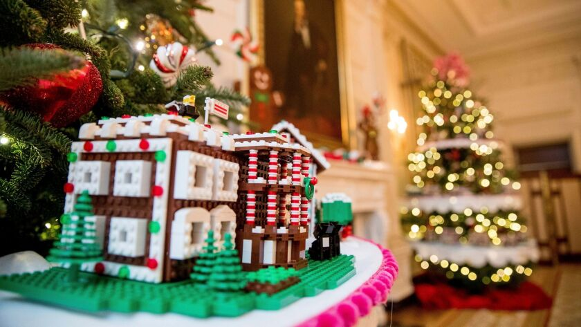 A Lego gingerbread White House is among 56 -- one for each U.S. state and territory -- on display inside the executive mansion this year.