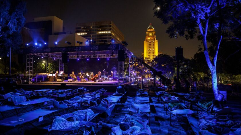 """Max Richter performs """"Sleep"""" as people lay in cots in Grand Park to sleep overnight as music plays w"""