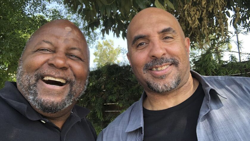 This photo provided by Mayer Brown LLP shows Kenneth Oliver, right, after his release from prison, p