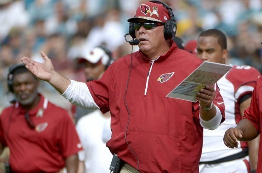 Arizona Cardinals Coach Bruce Arians questions a call by officials during the first half of a game against the Jaguars on Sunday in Jacksonville, Fla.