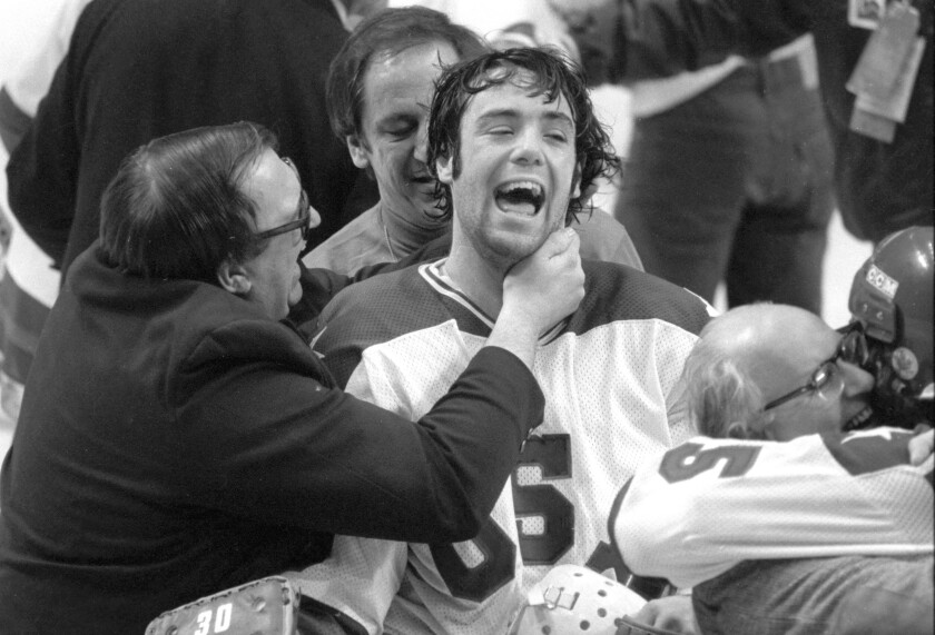 In this Feb. 22, 1980, photo, U.S. goaltender Jim Craig got a hug from goalie coach Warren Strelow after the Americans beat the Soviet Union at the Winter Olympics.