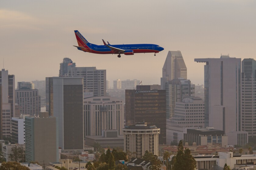 A passenger airliner on approach to San Diego International Airport.