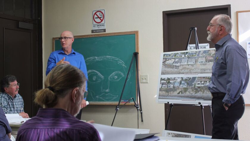 Tom Story and Robert Hawk speak of the geology of Bird Rock during their presentation about a seawal