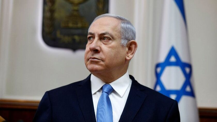 Israeli Prime Minister Benjamin Netanyahu leads a meeting at his Jerusalem office on Sunday.