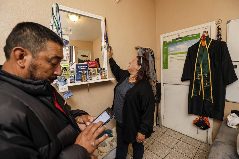 Ramon Flores and Maria Velasquez recall the accomplishments of their 23-year-old son, Jose Flores Velasquez.
