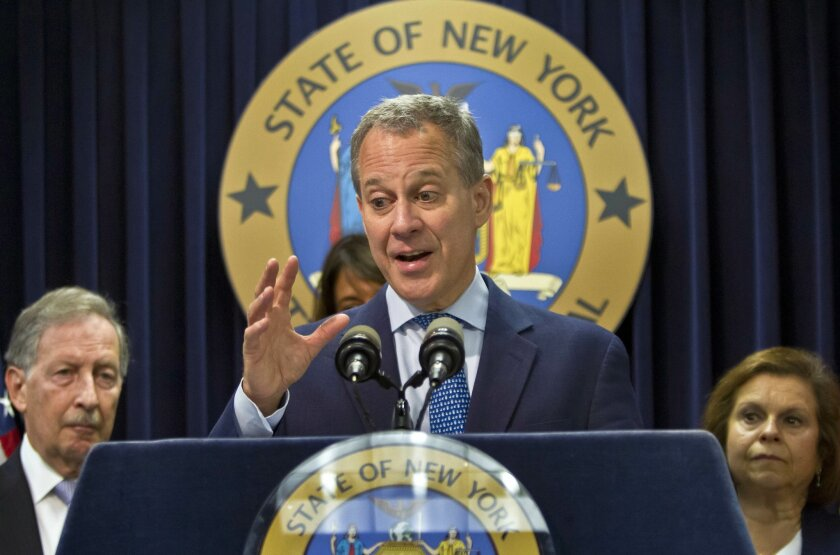 FILE - In this Aug. 21, 2014, file photo, New York Attorney General Eric Schneiderman, center, speaks during a news conference in New York. Schneiderman sent letters Monday, Feb. 23, 2015, to four manufacturers, in Long Island, California and Utah, demanding detailed ingredient and quality control information on every herbal supplement they sell in New York state. (AP Photo/Bebeto Matthews, File)