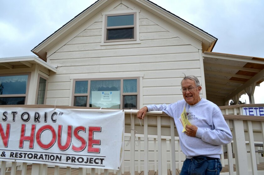 Dave Oakley, 87, stands in front of the nearly finished Teten House. Oakley has received praise for overseeing the rehab of the roughly 130-year-old house.