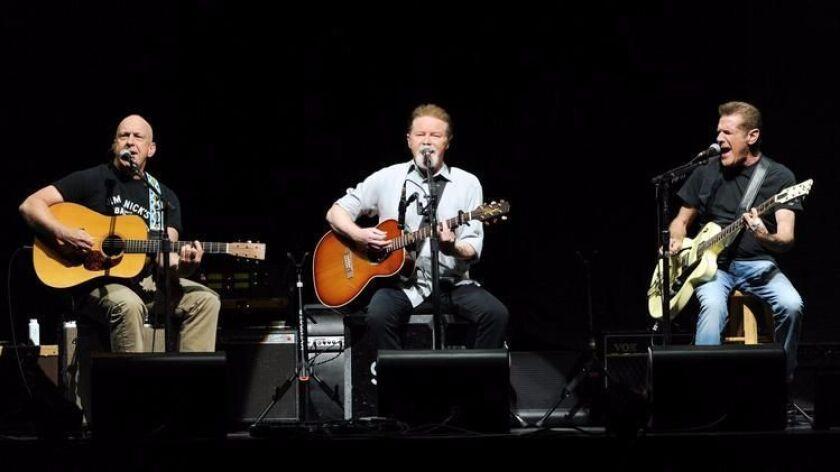 Former San Diegan Bernie Leadon, left, Don Henley and Glenn Frey of the Eagles perform at New York's Madison Square Garden on Nov. 8, 2013.