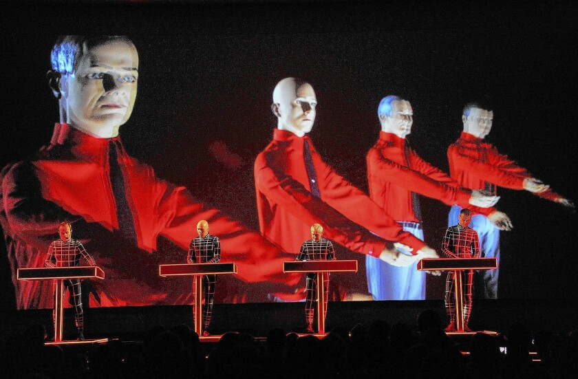 Ralf HŸtter, left, Henning Schmitz, Fritz Hilpert and Stefan Pfaffe of Kraftwerk at the Museum of Modern Art on April 10, 2012, in New York City.