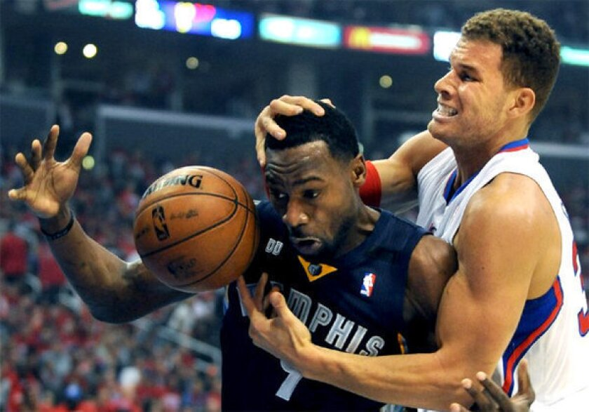 Clippers' Blake Griffin, right, battles Memphis Grizzlies' Tony Allen for a rebound.
