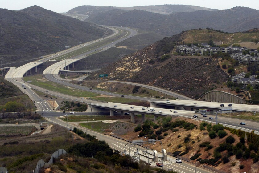 A view looking west from Aliso Viejo at the San Joaquin Hills Transportation corridor toll road where it crosses El Toro Road and snakes up the hill in Laguna Beach towards Newport Beach and Irvine. The photo was taken in 2004.