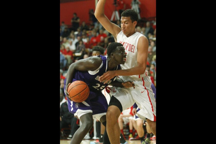 St. Augustine's Martin Tombe goes up against Mater Dei's Michael Cage in the first half.