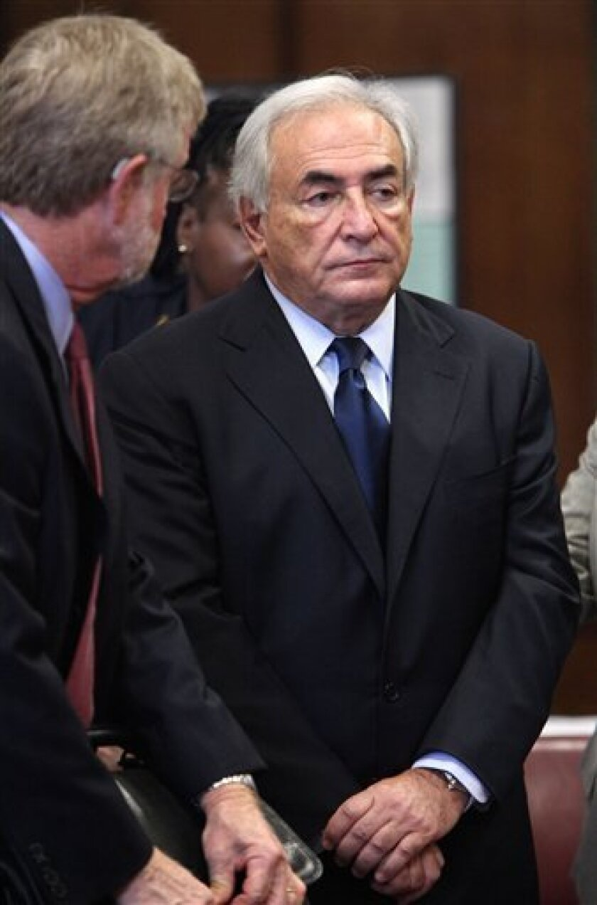 FILE - In this Monday, June 6, 2011 file photo, former IMF leader Dominique Strauss-Kahn, right, appears at his arraignment on charges of sexually assaulting a Manhattan hotel maid, at State Supreme Court in New York. Attorney William Taylor is at left.  A person familiar with the case says former